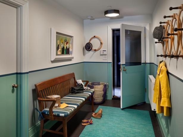 contrasting paint and outdoor rug in mudroom